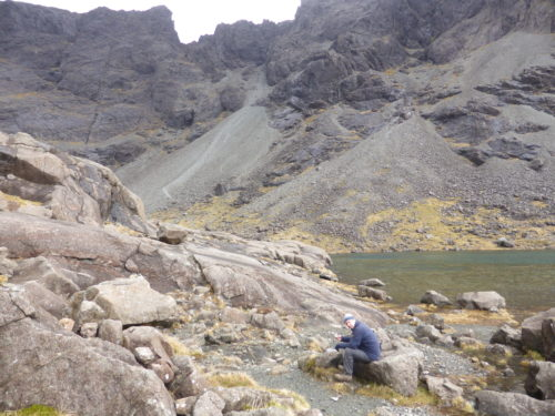 Francis eating lunch by Coire Lagan before ascent of Great Stone Shoot